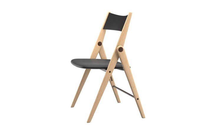 TheOslo Folding Chair has a solid oak base with black leather seat and backrest; $249 at BoConcept.