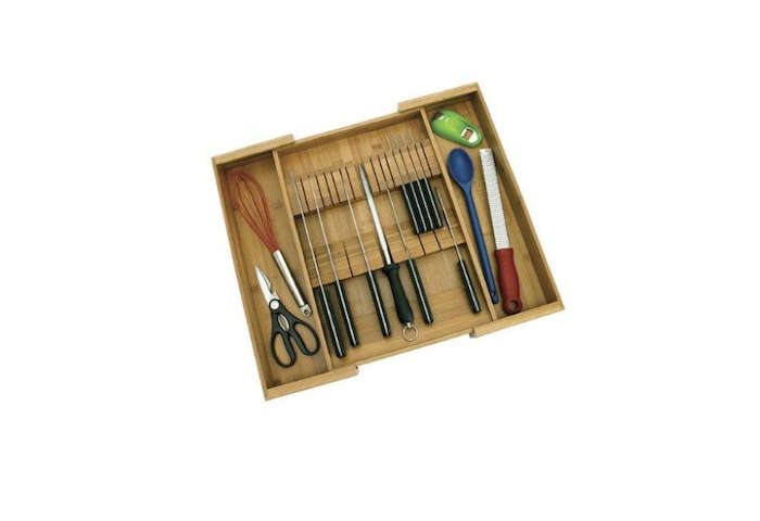 The Bamboo Expandable Knife Organizer by Lipper International stores kitchen knives and utensils; $12.37 from Amazon. For flatware drawers, see our previous post: Drawer Divider Roundup, which includes a vertical storage solution for the space pressed.