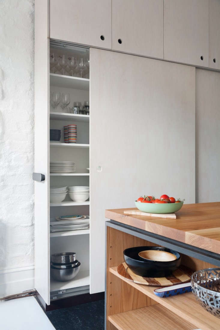 The narrow passage between the island and wall in this Melbourne, Australia, kitchen made normal doors a near impossibility. Sliding doors solved this small-space problem. See Kitchen of the Week: A Seventies Overhaul by Hearth Studio. Photograph by Christo Crocker.