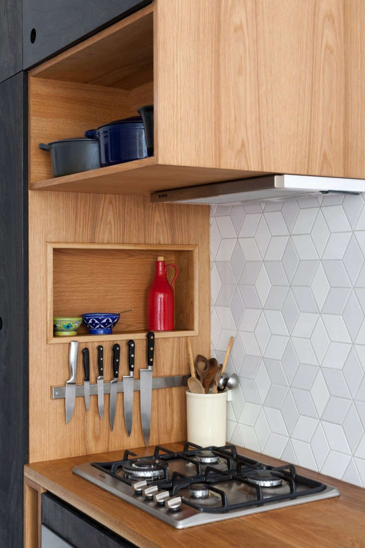 Trotter is also a stylist—and it shows in her designs. Open cubbies, alongside closed cabinets, allow homeowners to both store and show off pretty cookware, ceramics, or dinnerware.