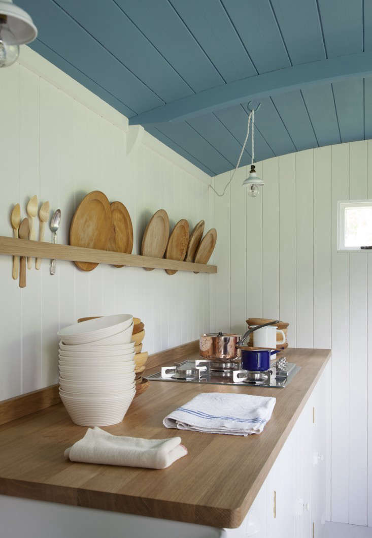 A single strip of wood functions as a plate rack in the British Standard Shepherd's Hut kitchen. ContactBritish Standardfor information.