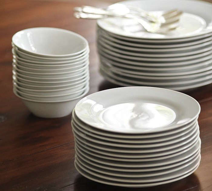 The Caterer's 12-Piece Dinner Plate Set includes a dozen dinner plates; $59 for a boxed set of 12 plates from Pottery Barn. A Caterer's Set of 12 Salad Plates and Caterer's Set of 12 Bowls are also available for $49 each.