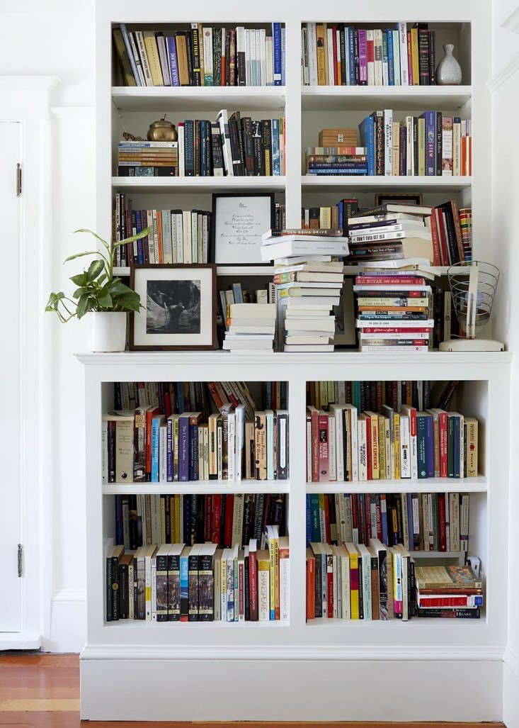 Leave it to a pair of writers to reimagine bookshelves. Novelists Ayelet Waldman and Michael Chabon had two tiers built into the lower shelves to accommodate their overflowing collection. SeeSerenity Now: A No-Drama Bedroom in Berkeley, CA. Photograph byAya Brackett.