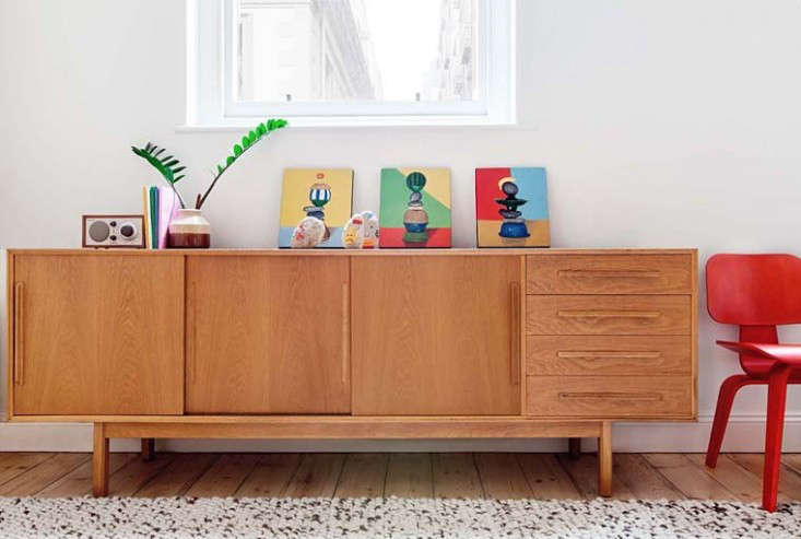 More handcrafted souvenirs from Fuog's work in Bali sit on a midcentury Danish sideboard.
