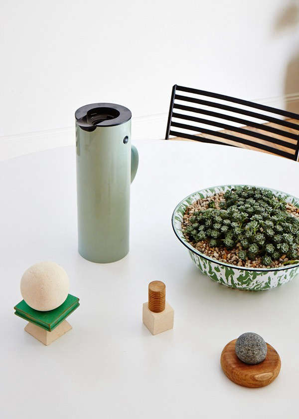 The stacking toys on the table are wooden prototypes handmade and developed in collaboration with Balinese craftsmen as part of Field Experiments, a three month design project Fuog undertook in Bali. We like the succulents in the graniteware bowl.