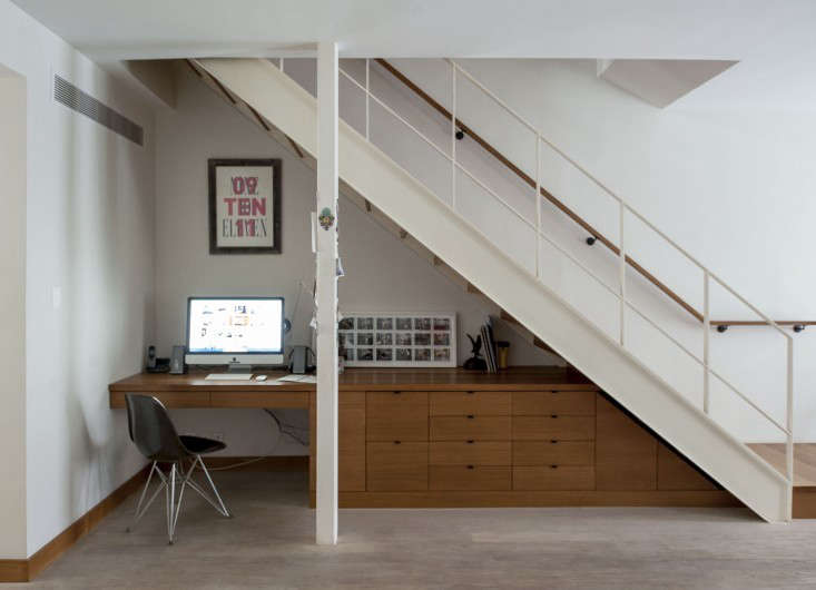 An under-the-stairs workspace from a project by Oliver Freundlich, in Brooklyn.(See the rest of the duplex at The Ultimate Starter Apartment, Cobble Hill Edition.) Photograph by Matthew Williams for Remodelista.