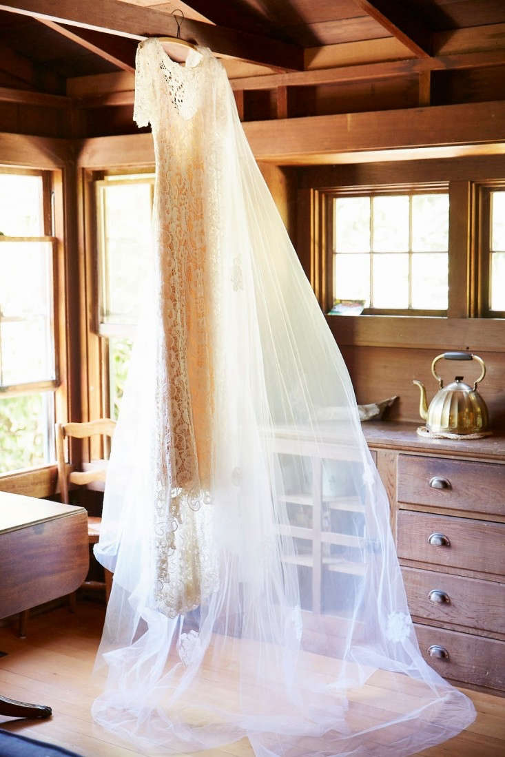 Wedding gowns are often composed of many materials, each of which requires different care. Pictured is interior designer Faye McAuliffe's lace gown by Ivy & Aster and dramatic veil, borrowed from the mother of the groom. For more on her wedding,seeThe DIY Wedding: An LA Designer's Boathouse Nuptials.