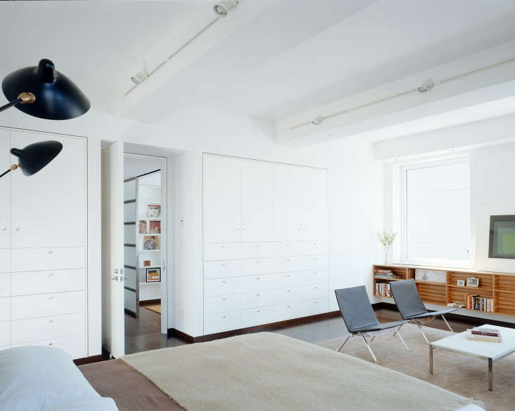 """""""The owners are minimalists, but they had large storage requirements,"""" says Jeff Sherman, of Delson or Sherman Architects. """"Thickening the walls and recessing the cabinets flush with the walls allows a great deal of cabinetry to recede almost to the point of invisibility.""""Photograph byCatherine Tighe, fromThe Architect Is In: Seeking Sunlight in Chelsea."""