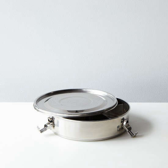 A tiffin spin-off, the stainless-steelDivided Airtight Container has four compartments and is 7 5/8 inches in diameter;$30 from Food52.