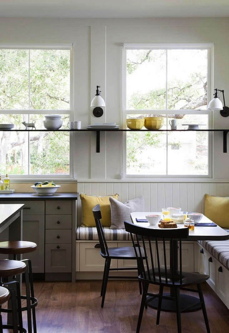 This modern farmhouse kitchen with built-in bench drawers was designed byTim Cuppett Architectof Austin.