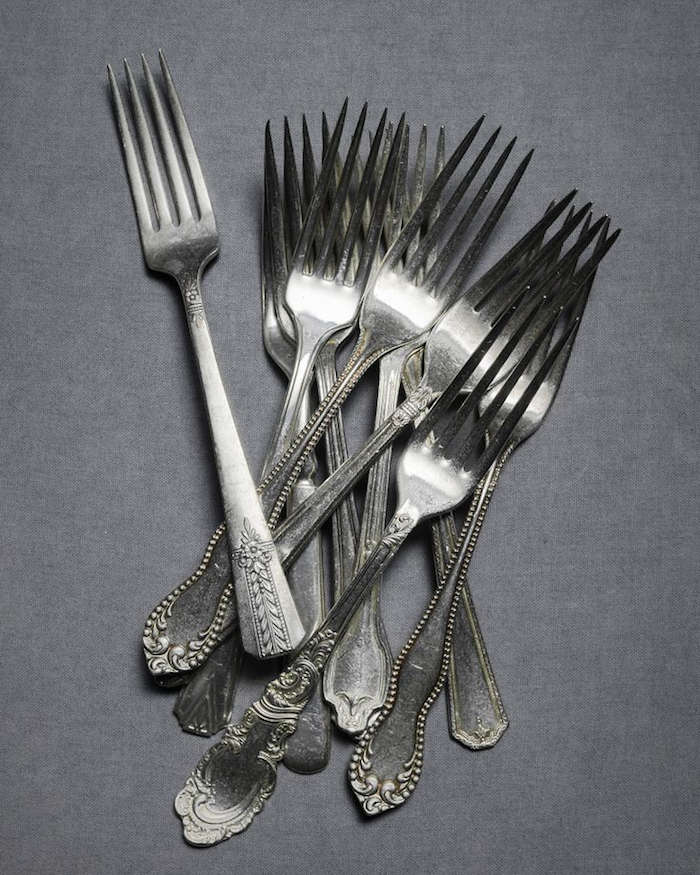 Source vintage silver-plated flatware in mismatched sets from flea markets or on Etsy. Photograph viaBhldn.