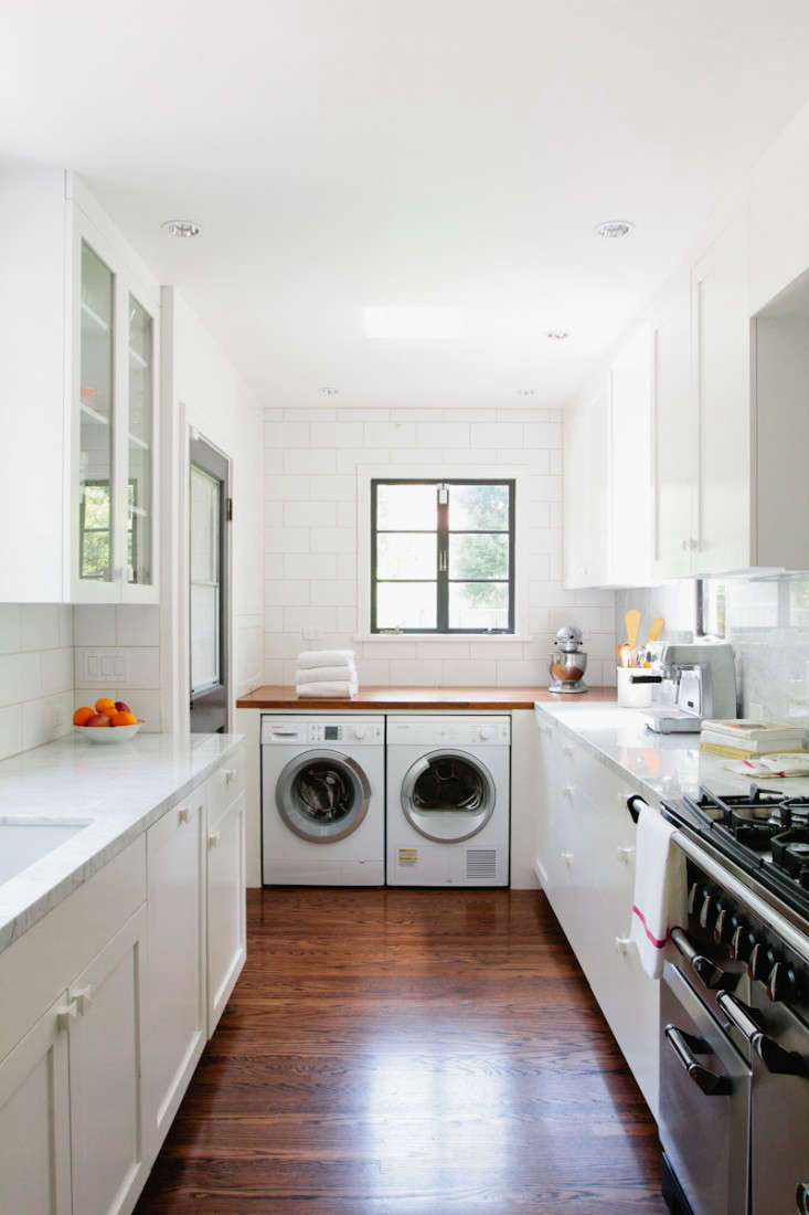 A great place to install a washing machine and dryer—at the bottom a the U-shaped layout. Photograph by Jessica Comingore for Remodelista, from A New England Kitchen by Way of LA.