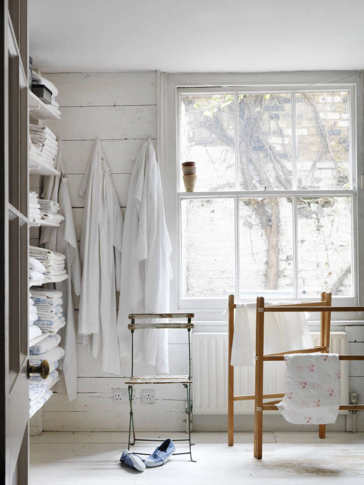 Hooks on a wall and open shelves mean a corner of any room can be turned into a linen cupboard or closet. Photograph by Simon Brown for Living Life Beautifully, from Required Reading: Living Life Beautifully.