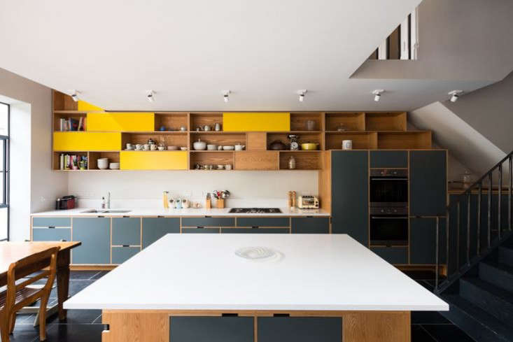 The bespoke cabinets, including the colossal island, are the work of Uncommon Projects, an architect-led London design-build firm specializing in plywood furniture.The counter and island are topped with Silestone (read about the material in our Remodeling 101 onEngineered Quartz Countertops).