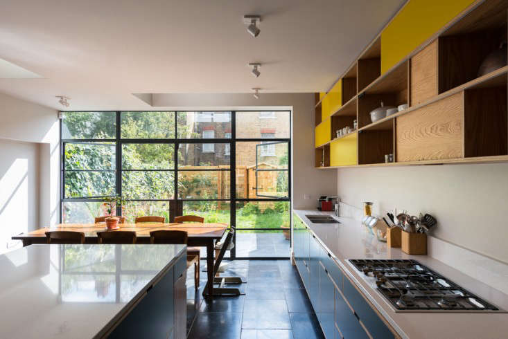The glass doors and windows visually enlarge the space and flood it with light and air.