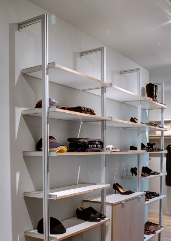 For an affordable modern closet, Nashville residential architect Marcus DiPietro likes the no-nonsense Rakks system's aluminum poles and rods. Here, DiPietro used Rakks components for a home closet with custom-made cabinets and shelves.