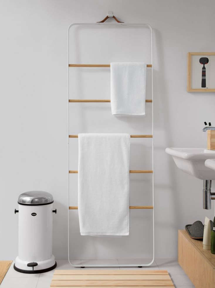 """Norm Architects calls the ladder """"an informal and flexible piece of furniture"""" that has use beyond the bathroom: Consider it for magazines, scarves, or clothes. TheMenu Bath Towel Ladder in white with light oak rungs is $449.95 at Design Within Reach."""