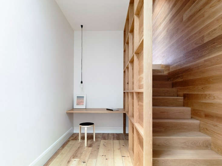 A workspace tucked next to a stairwell by Australia-based Rob Kennon Architects.Photograph by Derek Swalwell.
