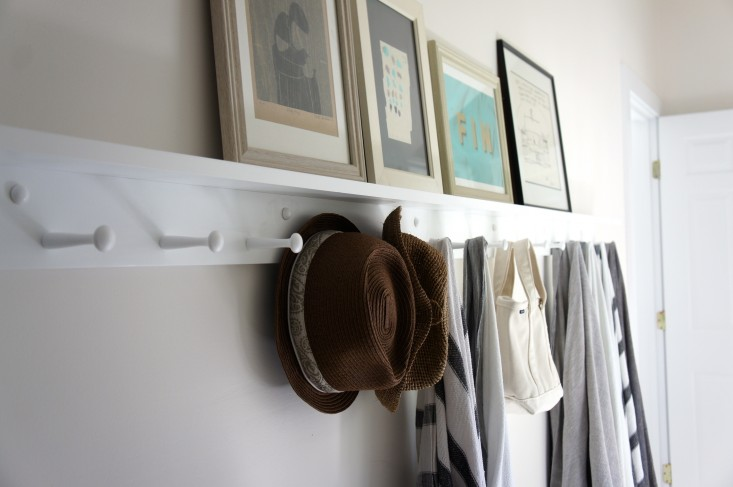 I purchased my Shaker peg rails from Peg and Rail, which offers a shelf and various finish options. We went for the shelf because it allows us to display art without having to commit to hanging it. Photograph by Christine Chang Hanway.