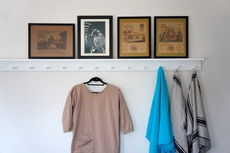 Thanks to the 8-foot length of rail that I installed in the master bedroom, my husband and I became neater as well. While sweaty tennis clothes and damp bathing suits hang from the teens' pegs, I display my favorite pieces of clothing, such as this artist's smock from Margaret Howell. See Artist Style: 7 Studio-Inspired Smocks for some of our other favorites. Photograph by Christine Chang Hanway.