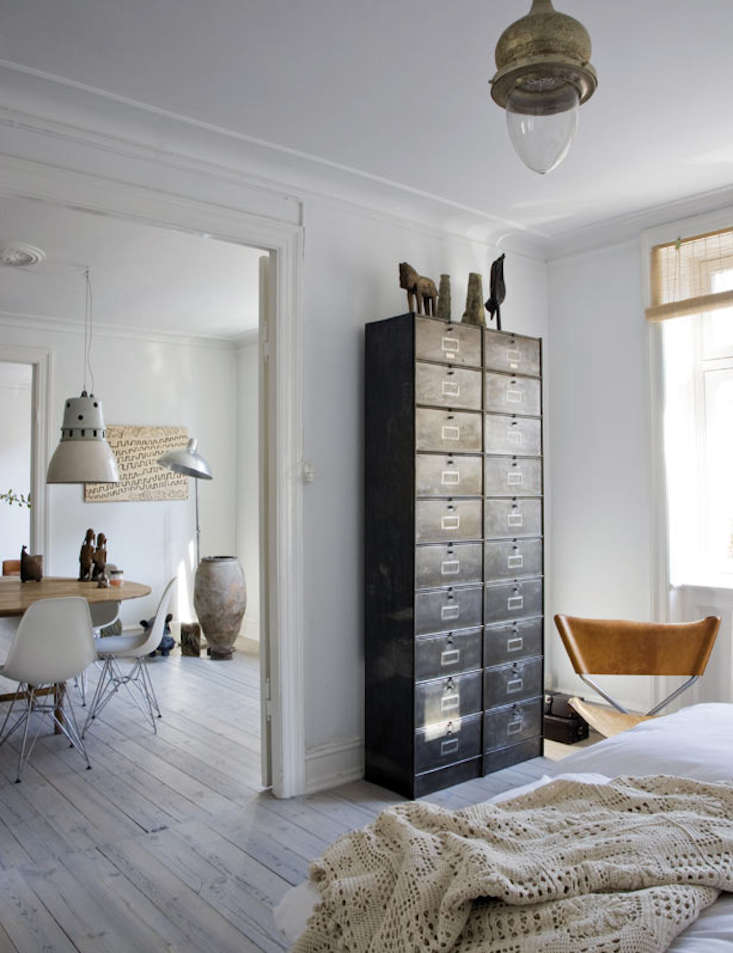 Metal cabinets in the bedroom of Danish designer Birgitte Rabens are used as a dresser. Photograph by Raul Candales forElle Decor Spain.