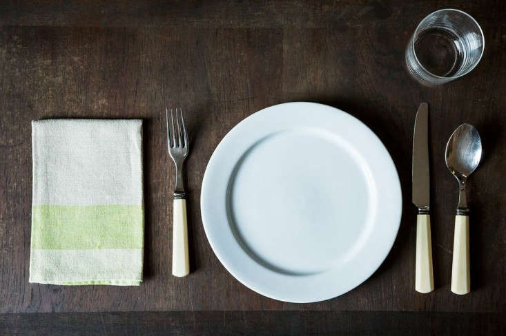 For weeknight dinners, the basic table setting includes a dinner plate, a fork, a knife, a spoon, a napkin (we're currently covetingHeirloomed Linen Napkins; $34 for a set of four), a drinking glass and a wine glass).