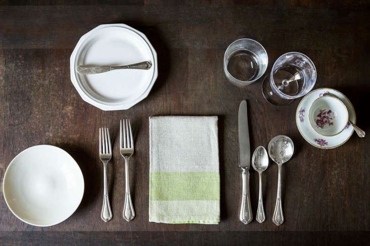 More formal than how you would set the table for a weeknight dinner but less formal than a full-on fancy affair.
