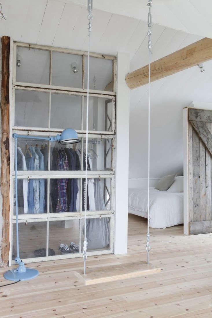 A closet door made from reclaimed windows in an Amsterdam house via Mechant Design.