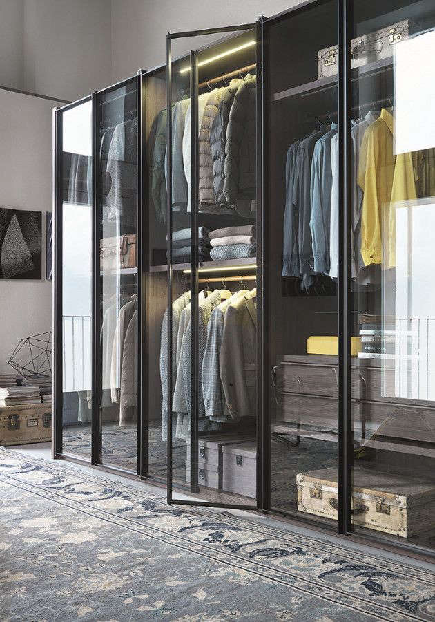 From Italian company Lema, the Armadio al Centimetro Aria is a modular wardrobe system with glass doors.