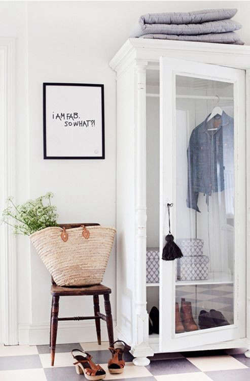 A painted armoire serves as entryway closet. Photograph via It's Monday but It's OK.