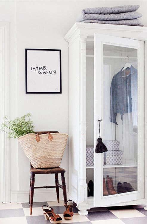 A painted armoire serves as entryway closet. Photograph via It's Monday but It's OK.