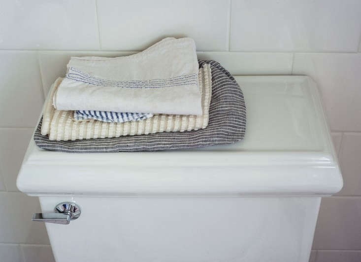 A pile of pretty towels at the ready. Photograph by Matthew Williams for Remodelista, styling by Alexa Hotz, from Expert Advice: 10 Tips for Transforming a Rental Bath.