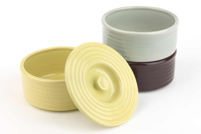 Made by the revived Bauer Pottery, these Stacking Refrigerator Canisters are 5 3/4 inches in diameter, 2 1/2 inches tall, and designed to stack; $50 each. Bauer also offers the containers in 14 colors.