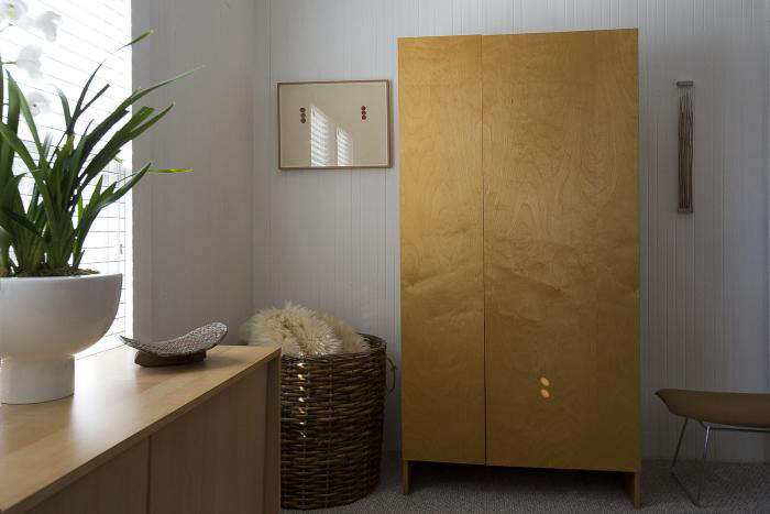 A custom maple wardrobe that Wendy designed. The basket is refurbished with rope handles.