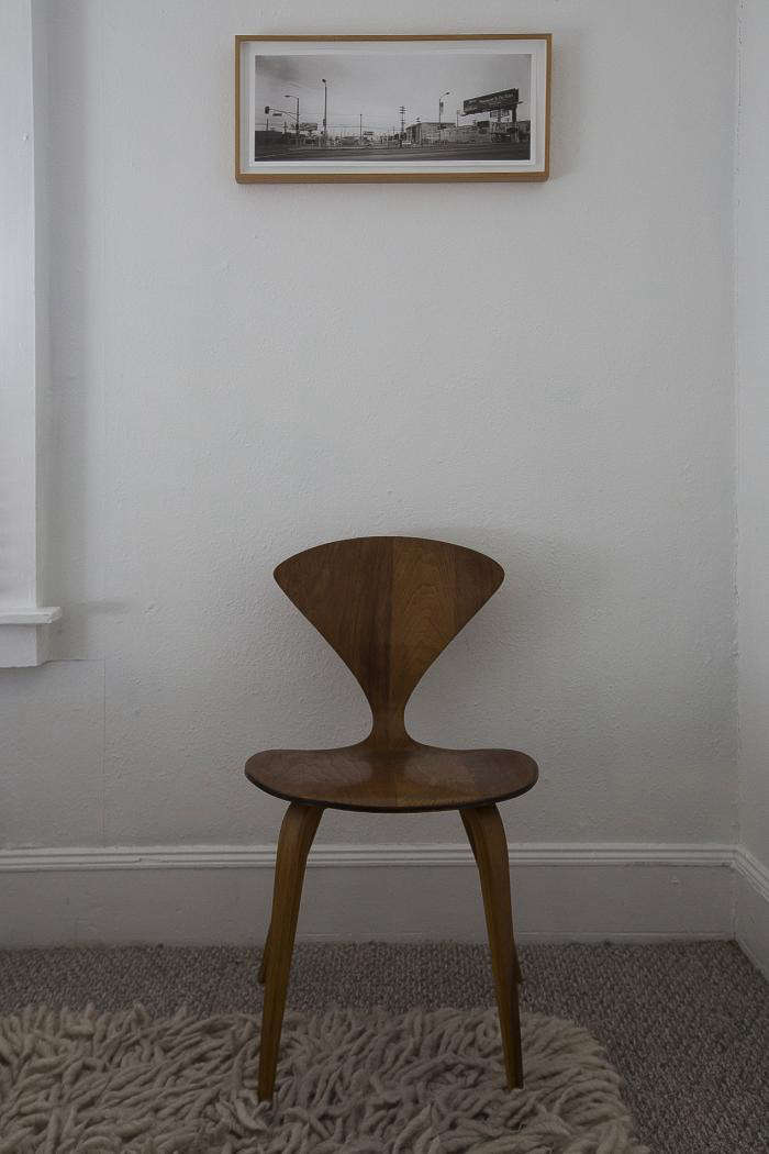 A solo Cherner side chair and a single framed photograph are all that are needed to make this corner interesting.