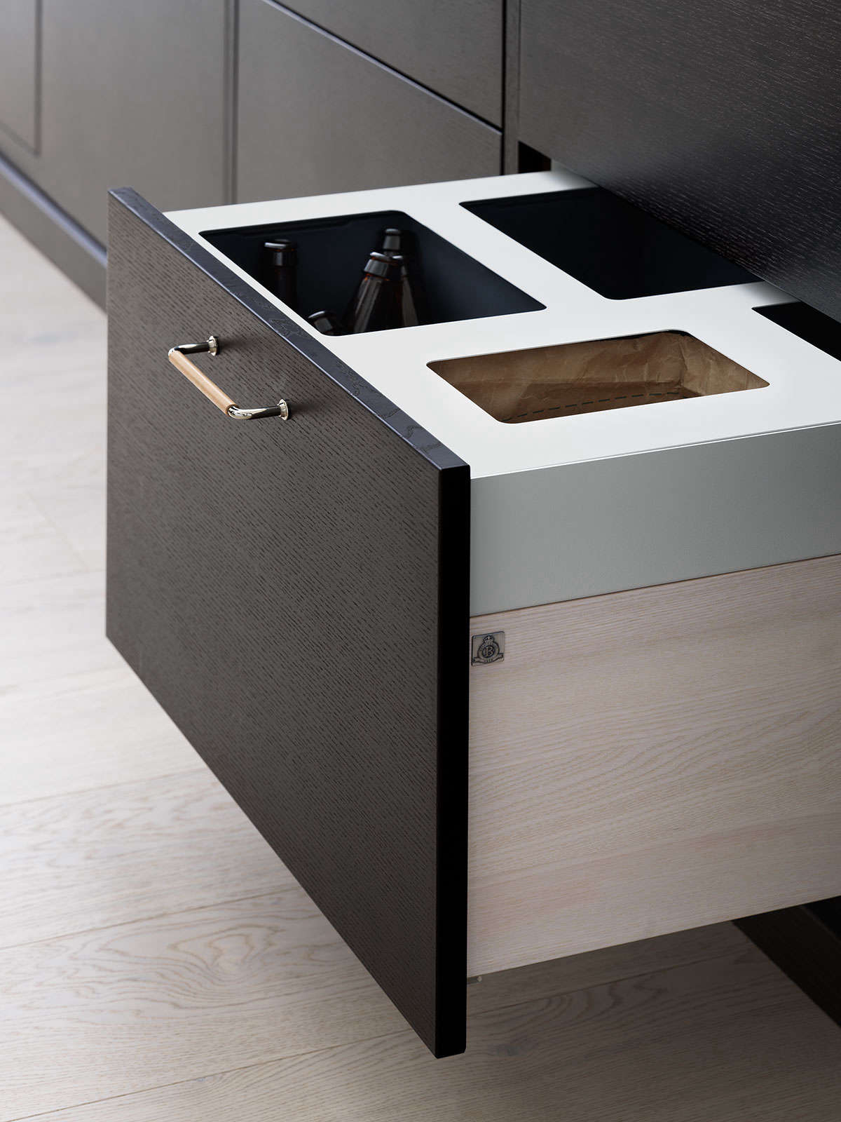 Swedish company Ballingslöv's Bistro kitchen system features a garbagedrawer with separate recycling compartments for glass, paper, food waste, and metal. SeeA Swedish Kitchen with a Place for Everything.Photograph courtesy ofBallingslöv.