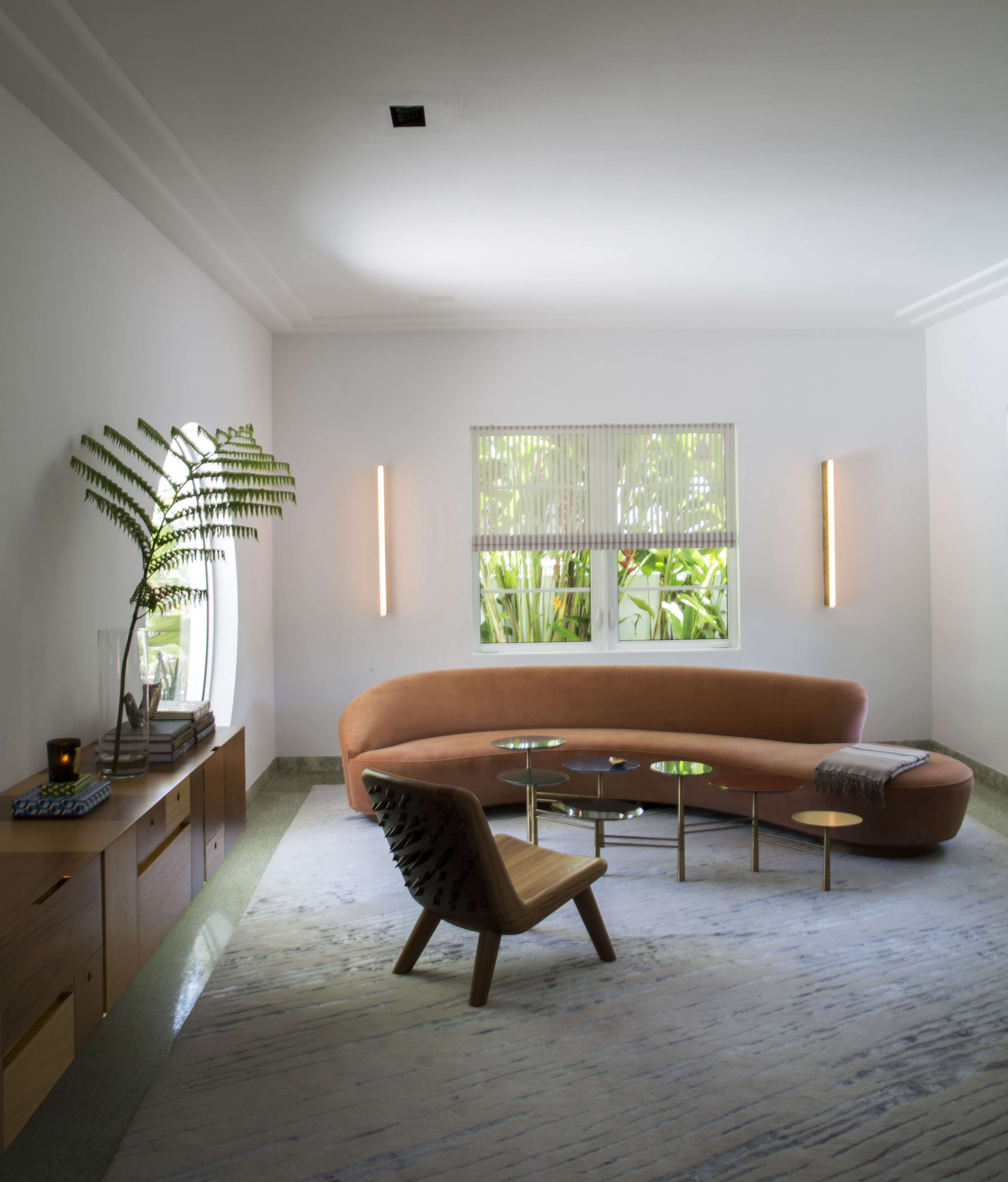 Living room with Vladimir Kagan sofa in Miami art deco villa remodel by Stephan Weishaupt, owner of Avenue Road, Max-Zambelli-photo   Remodelista