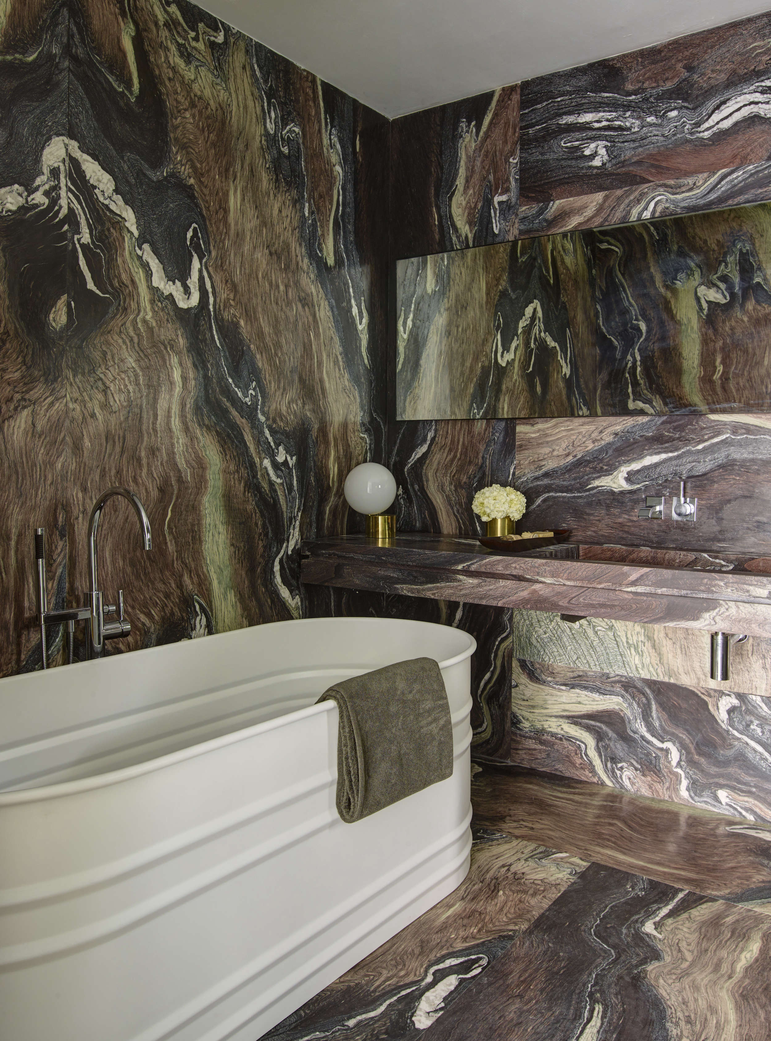 Dramatic brown marble bath in a revived 1932 Miami villa belonging to contemporary furniture dealer Stephan Weishaupt of Avenue Road, Richard-Powers photo   Remodelista
