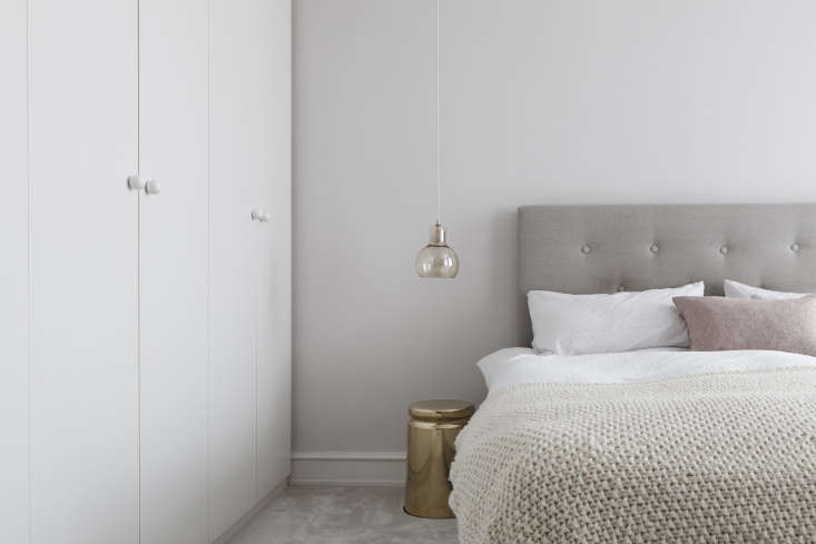 Master bedroom in a luxe-minimalist apartment remodel by Studio Oink in Mainz, Germany | Remodelista