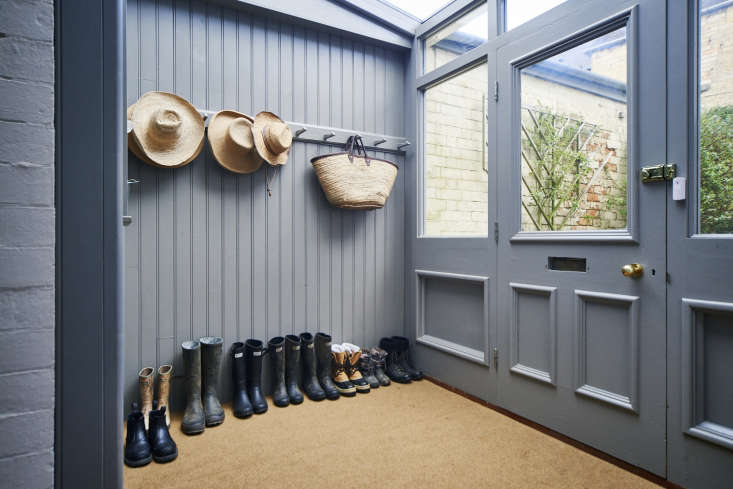 A proper English country house must have a dedicated spot for rain boots. Here, boots line up casually below a classic peg rail in the entry to the house. (Looking for something to keep your boots off the ground? Check out our 10 Easy Pieces roundup of great-looking welly racks from the UK.)