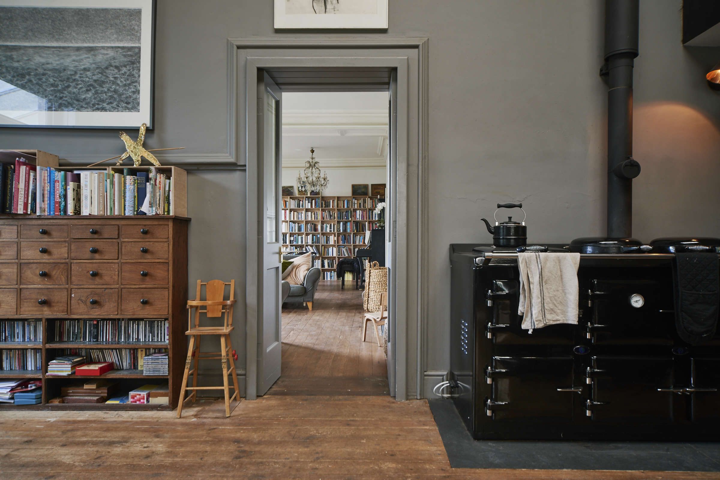 English kitchen/dining room: London theater designer Niki Turner's remodeled kitchen with classic black range-cooker | Remodelista