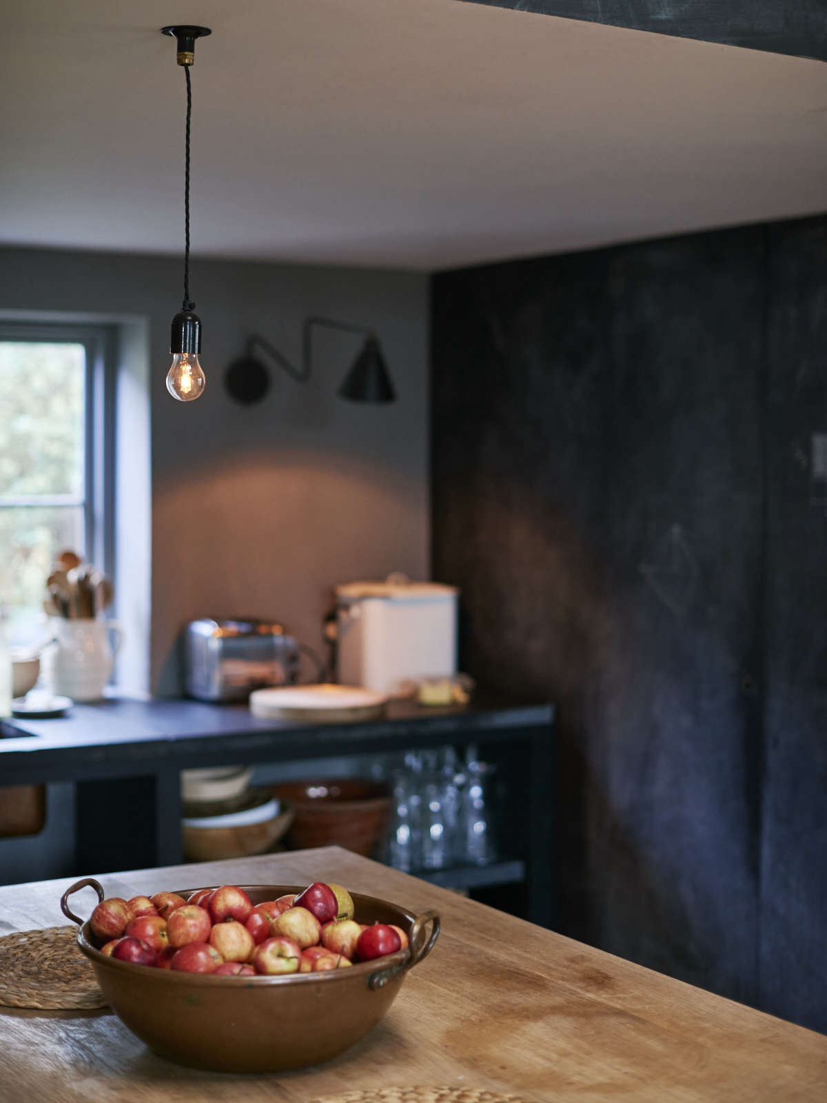 London theater designer Niki Turner's chalkboard painted kitchen in a former billiard room in a historic house in Gloucestershire | Remodelista