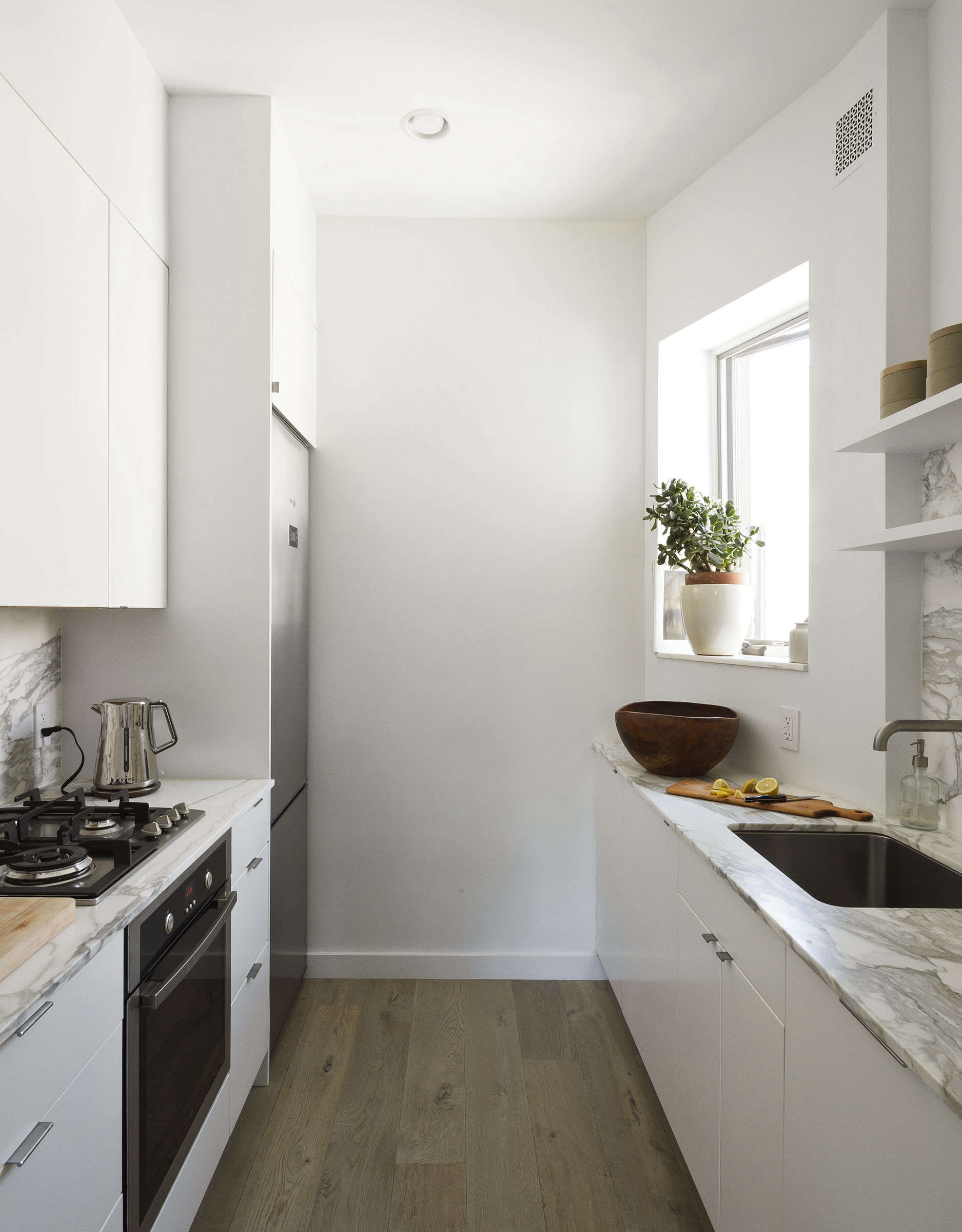 Ikea galley kitchen in Jacqueline-Schmidt and David Friedlander's 675-square-foot Brooklyn quarters, Matthew-Williams-photo | Remodelista
