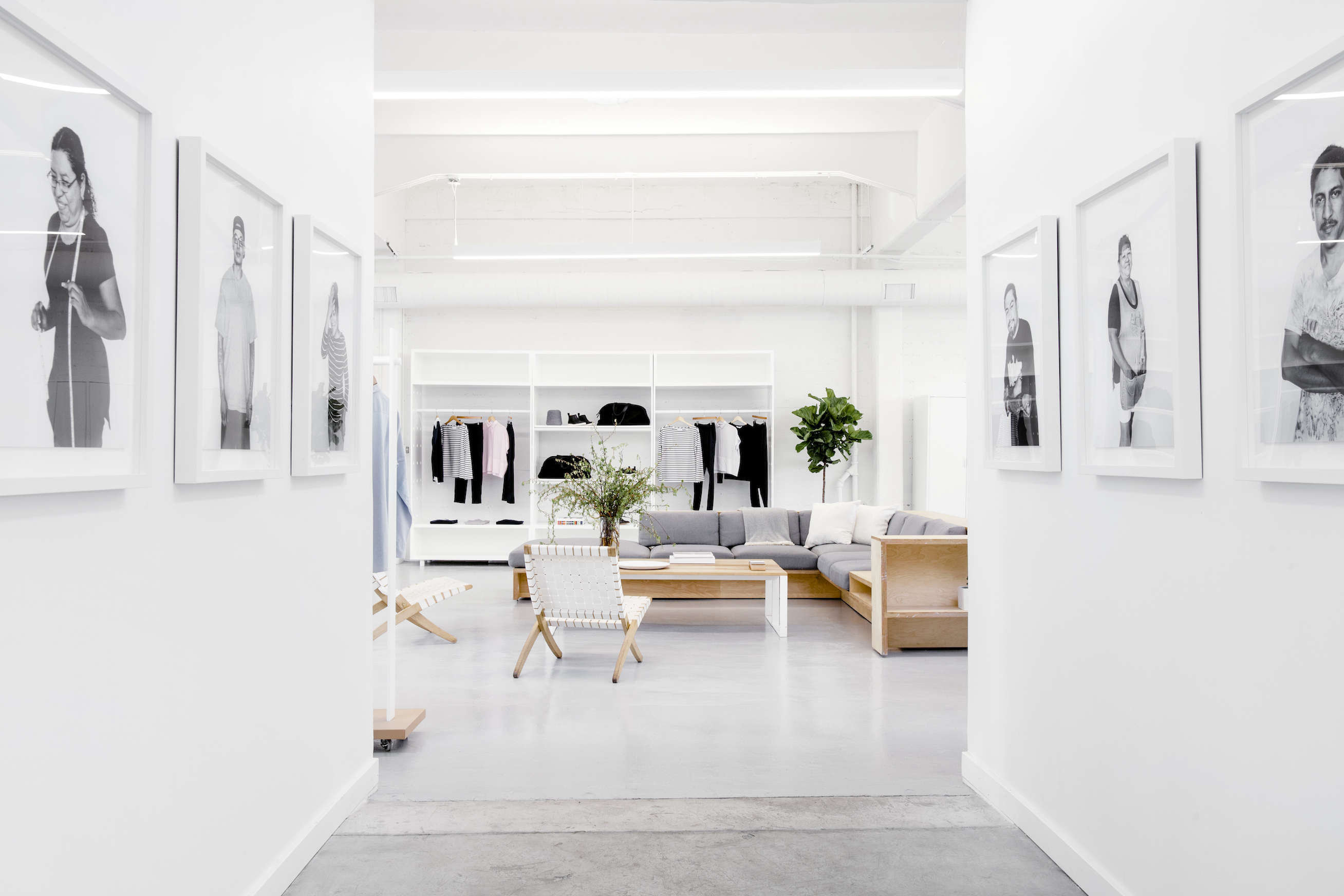 Factory worker portraits in Everlane's lofty white office in SF, Carlos Chavarría photo | Remodelista
