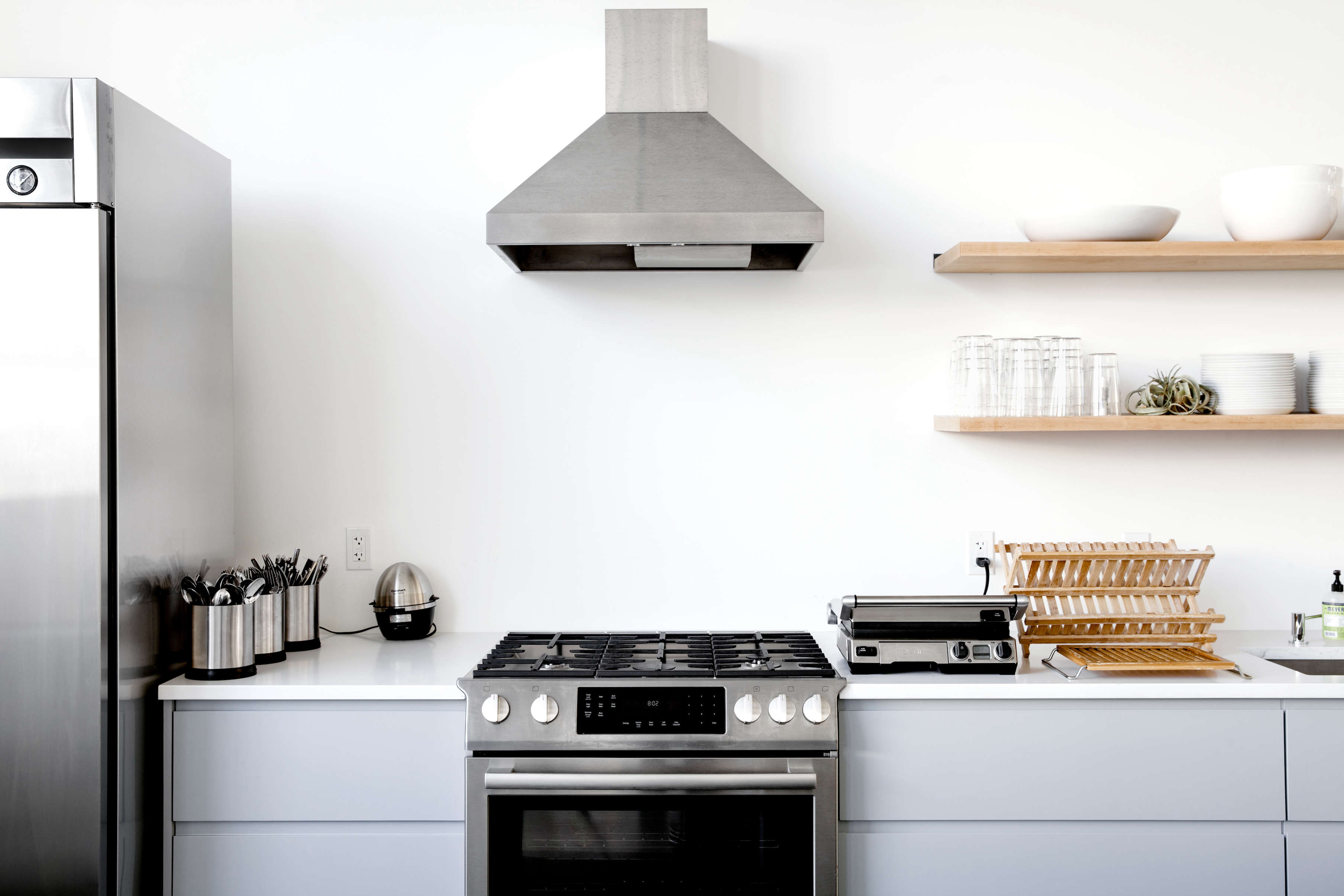 Gray kitchen cabinets in Everlane's office in SF, Carlos Chavarría photo | Remodelista