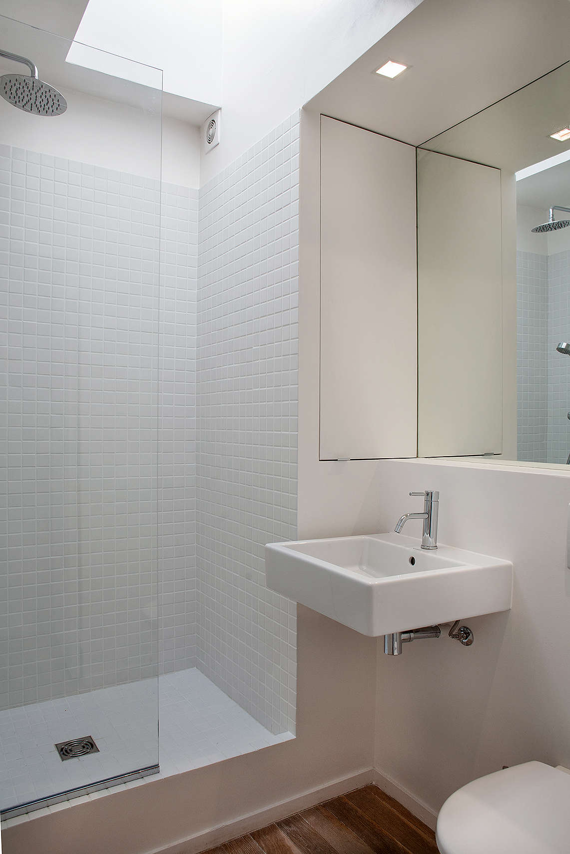 white bathroom in a compact Paris apartment designed by Philippe Harden | Remodelista
