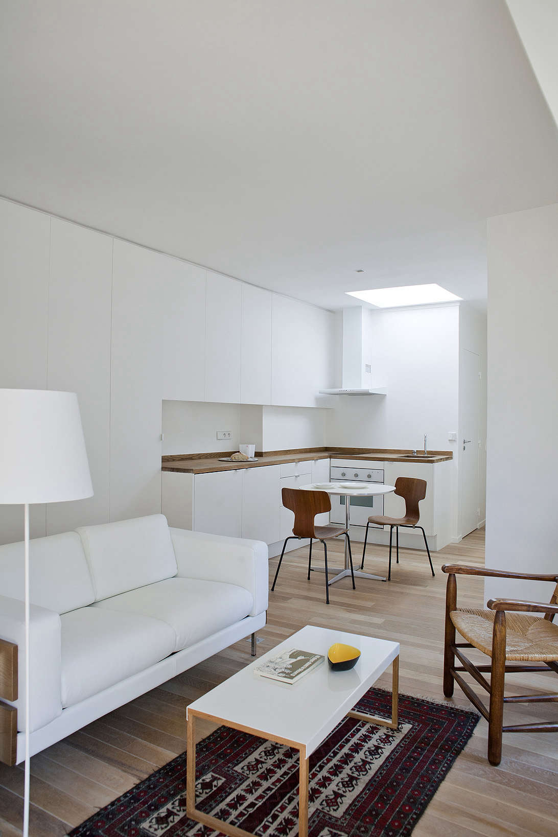 Paris all-white pied-a-terre, a garret remodel in Montparnasse by architect Philippe Harden | Remodelista