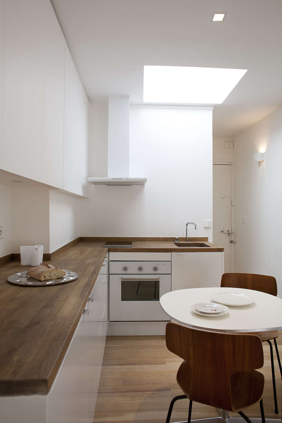 Ikea kitchen in a Paris pied-a-terre, a garret remodel in Montparnasse by architect Philippe Harden | Remodelista