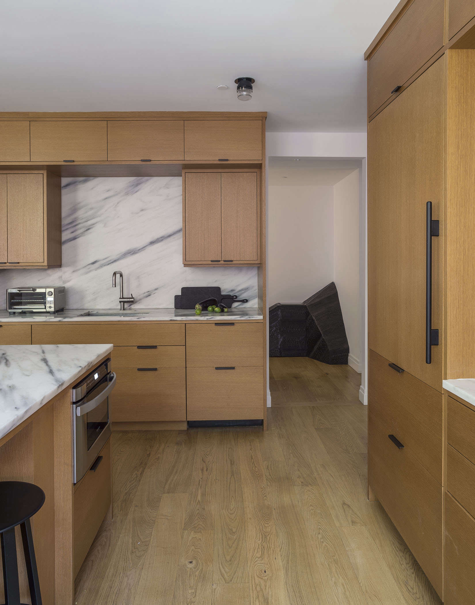 Oak kitchen cabinetry with marble counters and backsplash in NYC apt, Matthew Williams-photo | Remodelista