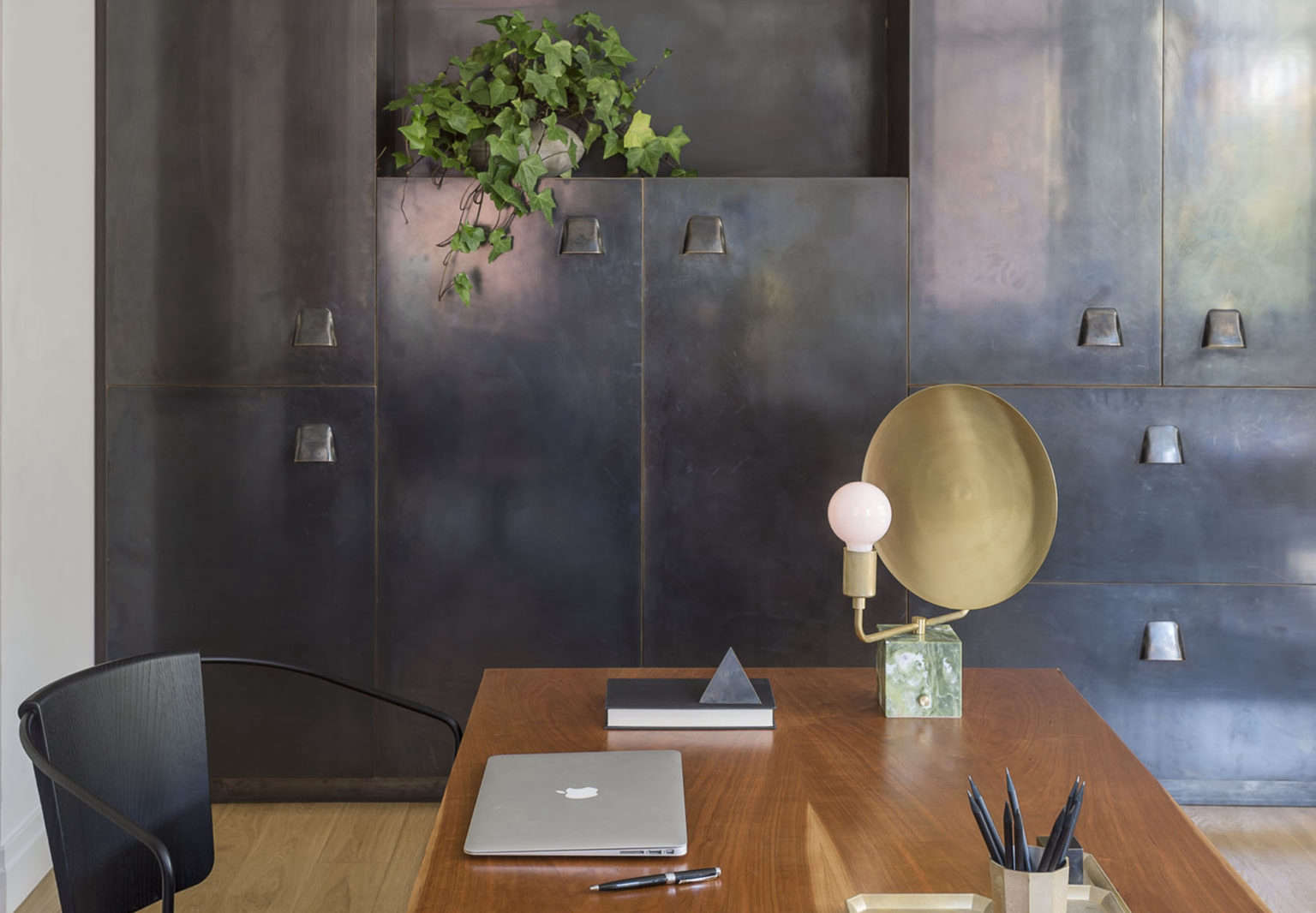 Family room by Workstead with blackened brass cabinets inspired by lockers | Remodelista